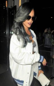 Singer Rihanna added an gray ombre to her long locks.