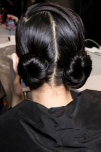 Styling your hair into knots is a go-to look this fall.